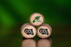 Concept of carbon footprint with icons on wooden logs