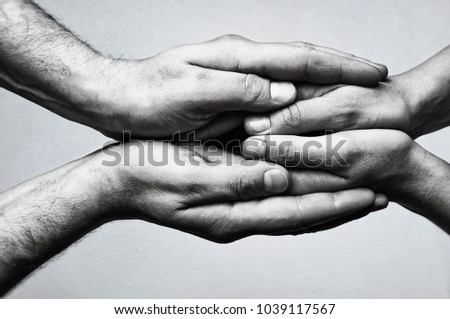 Photo of  Concept of caring, tenderness, protection. Male and female hands touch each other.