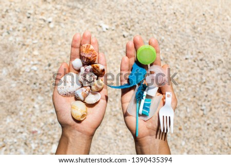 Concept of choice: save nature or continue to use disposable plastic. One hand holding beautiful shells, in the other - plastic waste. Beach sand on background. Environmental pollution problem. #1390435394