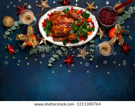 Concept of Christmas or New Year dinner with roasted chicken and various vegetables dishes. Top view.