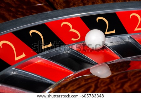 Concept of classic casino code 2-2-3-2-2 lucky numbers roulette wheel with black and red sectors and white ball #605783348