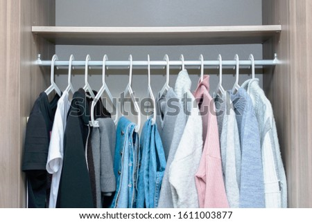 Concept of clothes and wardrobe. Clothes racks with clothes, close up