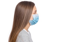 Concept of coronavirus quarantine. Side view, Child wearing medical protective mask to health from influenza virus, isolated on white background. Portrait of Teen girl in protective face mask, profile