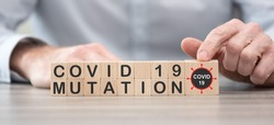 Concept of Covid-19 mutation on wooden cubes