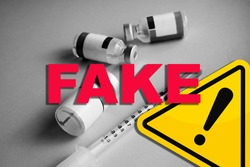 Concept of Covid Vaccines fake news and hoax. False information. Danger sign. Spread of lies around laboratories and vaccines for coronavirus. Speculation and misinformation about medical solutions.