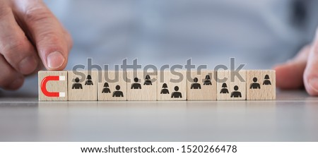 Concept of customer attraction on wooden cubes
