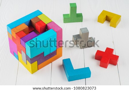Concept of decision making process. Concept of creative, logical thinking. Different geometric shapes wooden blocks on white wooden background. Geometric shapes in different colors.