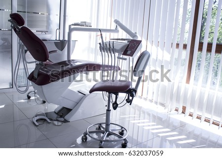 Concept of dental. stomatology concept - interior of new modern dental clinic office with red chair.. Dental equipment