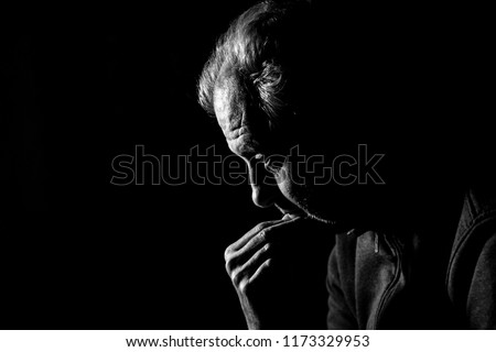 Concept of depression. Man staring at nothing in the dark in black and white