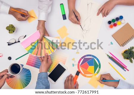 Concept of designer teamwork. Group of business people planning for a new project #772617991