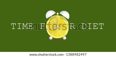 Concept of diet. Time for diet. Alarm clock lemon on a green background.Healthy food. Healthy lifestyle. Background.