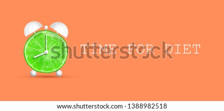 Concept of diet. Time for diet. Alarm lime on a coral background. Healthy food. Healthy lifestyle. Background.