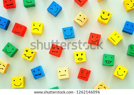 concept of Different emotions drawn on colorfull cubes, wooden background. #1262146096