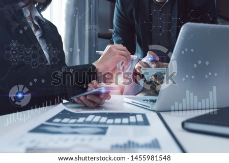 Concept of digital diagram,graph interfaces, Connections icon,Teamwork at business meeting, Business people working with laptop and tablet talking together in the modern Office. #1455981548