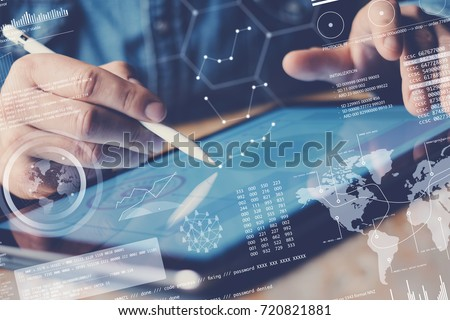 Concept of digital diagram,graph interfaces,virtual display,connections icon.Businessman working contemporary electronic tablet at office.Blurred background. Horizontal