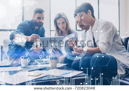 Concept of digital diagram,graph interfaces,virtual screen,connections icon on blurred background.Coworking team at business meeting.Group of colleagues working with startup project in modern office