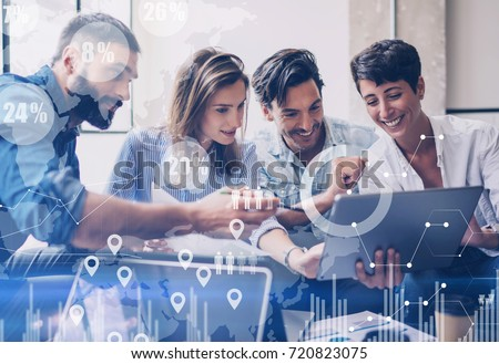 Concept of digital diagram,graph interfaces,virtual screen,connections icon on blurred background.Group of colleagues working with startup project in modern office..Horizontal