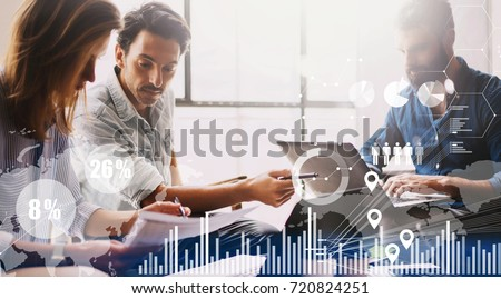 Concept of digital diagram,graph interfaces,virtual screen,connections icon on blurred background.Group of three young coworkers working together at modern coworking studio #720824251