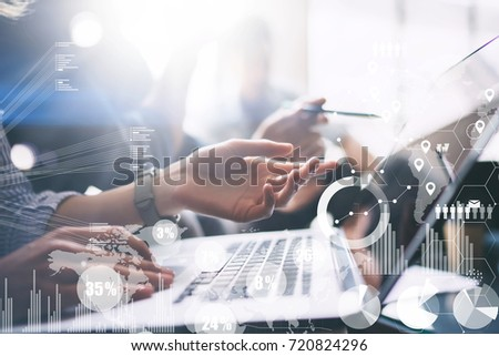 Concept of digital diagram,graph interfaces,virtual screen,connections icon on blurred background. Business meeting process.Female hand pointing to laptop computer display.Horizontal #720824296