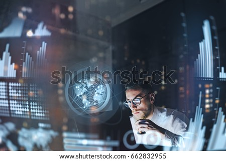 Concept of digital diagram,graph interfaces,virtual screen,connections icon.Young entrepreneur working at modern office.Man using contemporary laptop at night,blurred background.Horizontal #662832955