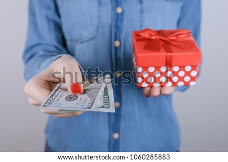 Concept of discount, sale, winning,   consumerism, people, person, beauty, fashion. Cropped close up photo portrait of excited glad lady buying holding getting present isolated on gray background