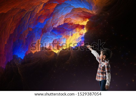 Concept of early childhood education, painting, talent. Boy are Imagine coloring with brush on night sky. #1529387054