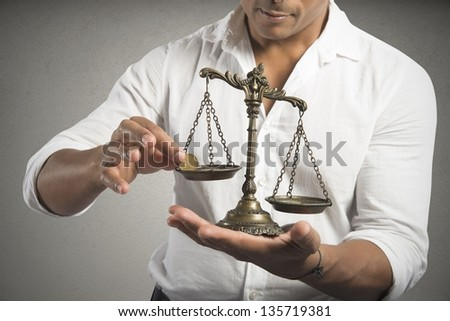 Concept of earning balance with businessman that weighs the money - stock photo