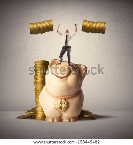 Concept of earning of a businessman who raises money as weights