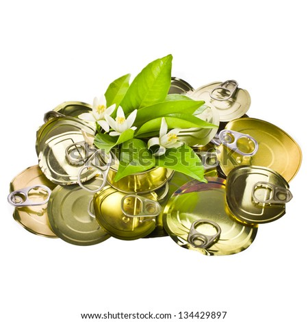 concept of ecology and recycling - use the cover of canned and fresh leaves with flowers isolated on white background