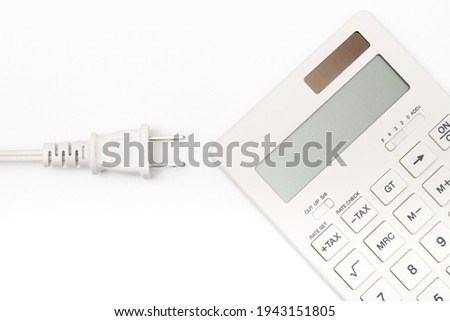 Concept of electricity charge (calculator and plug) Foto stock ©