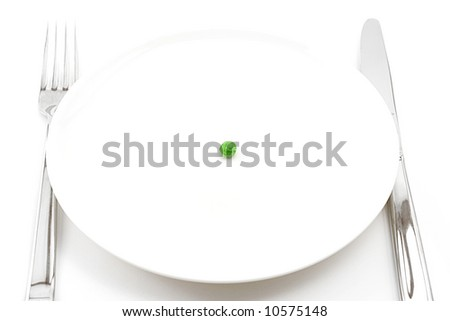concept of extreme dieting (single pea on a plate), shot on white