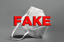 Concept of fake medical mask respirator. Prevention of the spread of coronavirus pandemic COVID-19 SARS-COV-2. False certification (FFP2, FFP3, KN95). Hoax or fake information about surgical masks.