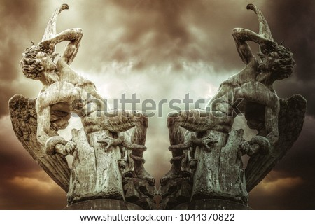 concept of fallen angel, demons and punishment of God. Devil sculpture in madrid, spain #1044370822