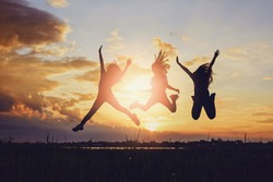 Concept of female friendship.Happiness friends at sunset time.