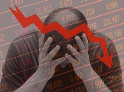 Concept of financial crisis . Business man or market operator or trader or middle aged man holding his head in his hands while the markets plunge on a descending stock curve background.