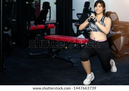 Concept of fitness.Woman exercising at the gym is doing a plank.balance body.endurance and motivation.