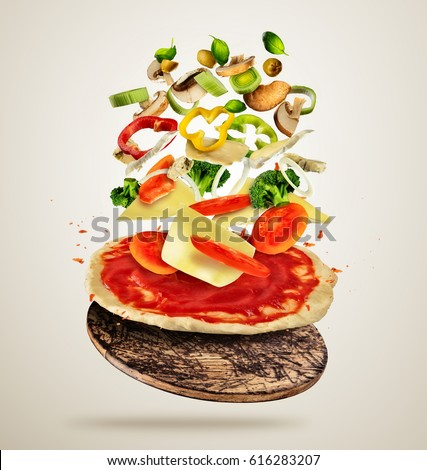 Shutterstock Concept of flying ingredients with pizza dough, isolated on creamy background. Food preparation, fresh meal ready for cooking