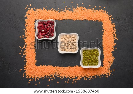 Concept of frame of lentils. in the center of the vases with various legumes. Healthy and dietary food