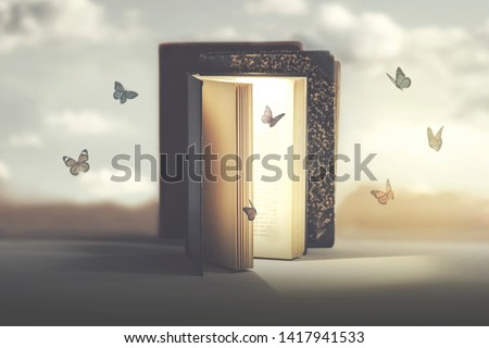 concept of freedom and fantasy of butterflies coming out of a mysterious book