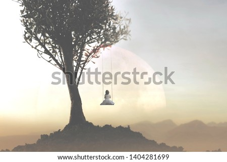 concept of freedom and relaxation of a young girl swinging on a swing in front of a surreal landscape