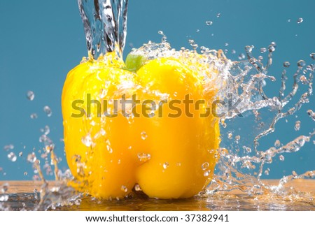 concept of fresh vegetable, splash and yellow bell pepper