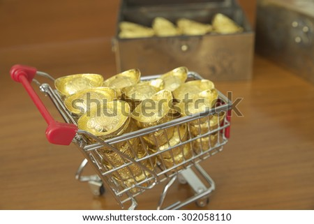 Concept of gold treasuring into treasure chest by pushcart. The chinese words are crafted into gold with meaning of good fortune, best of luck, and good health.