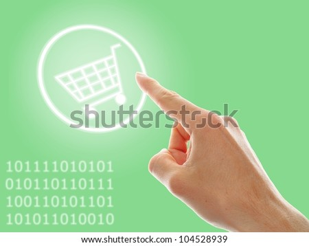 concept of growing e-commerce. shopping cart and numbers