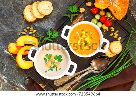 Concept of healthy vegetable and legume soups. Pea soup, pumpkin cream soup, mushroom cream soup and ingredients. Top view