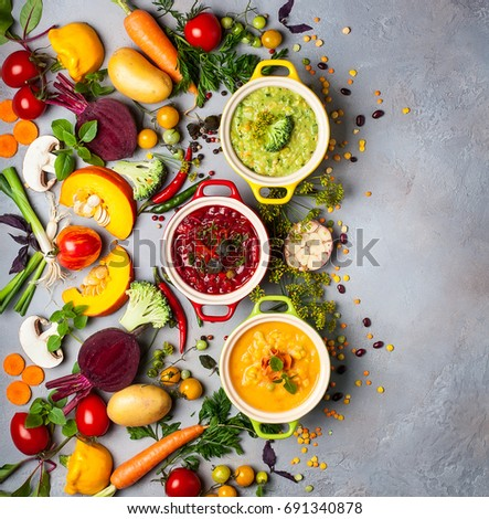 Concept of healthy vegetable and legume soups. Yellow pea soup,red borscht with bean and green broccoli with lentil soup. Top view.