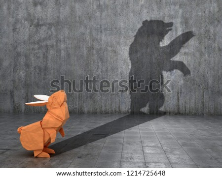 Concept of hidden potential. Paper figure of a rabbit that throws a bear's shadow. 3D illustration