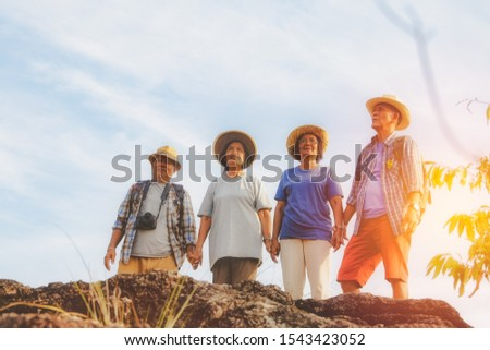 Concept of hiking activities for the elderly : Group of elderly, Asian, elderly tourists, traveling nature, happy when traveling together with goals.