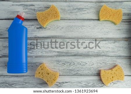 Concept of household. Household chemicals on light wooden background top view. Detergent #1361923694