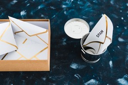 concept of inbox organisation and clean-up, spam email envelopes with trash can and box with other emails metaphor of inbox