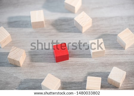 Concept of individuality with wooden cubes